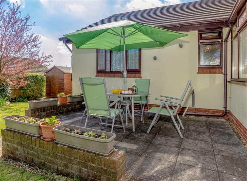 Patio with outdoor furniture at Devon Retreat in Paignton, Devon