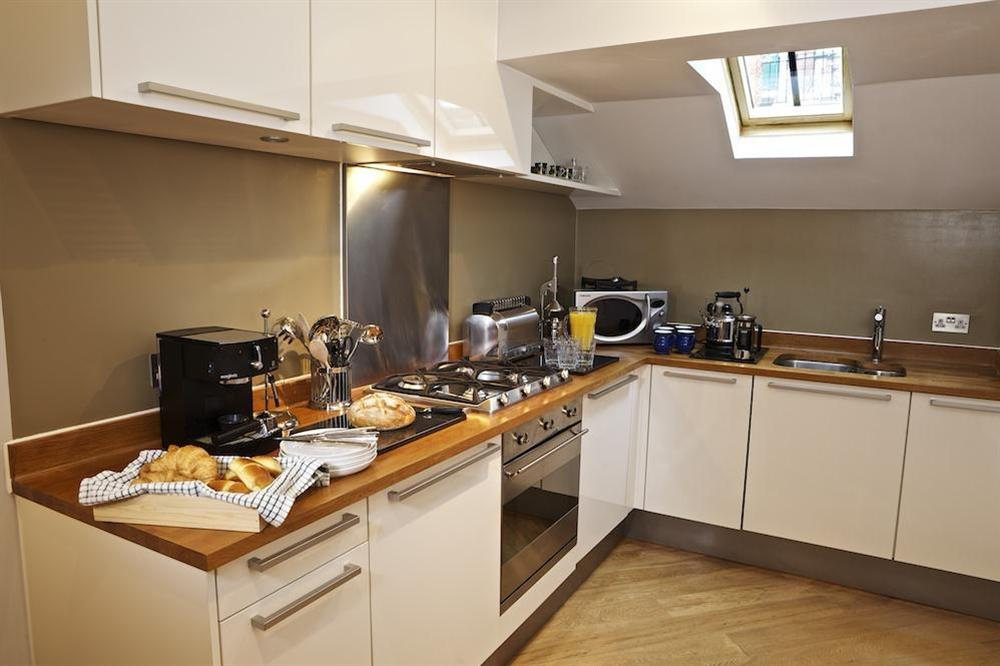 The contemporary kitchen makes self catering a pleasure at Diddly Squat, 43 Dart Marina in , Dart Marina