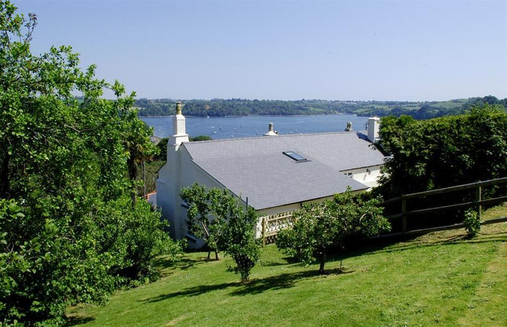 A picture taken from Dower House's orchard with views over its roof and the River Dart beyond at Dower House, Dittisham