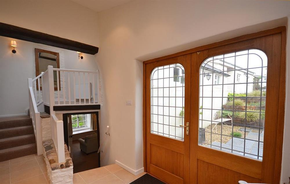 The entrance hall with stairs down to the living areas and stairs up to the bedroom landing at Dower House, Dittisham
