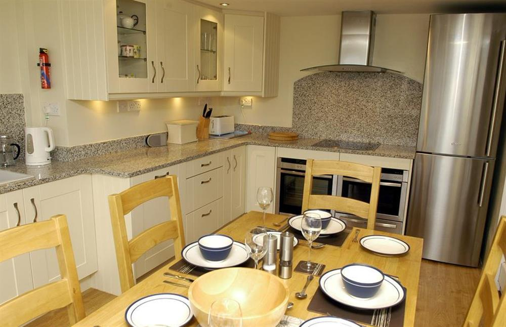 The kitchen is equipped with a selection of high specification appliances at Dower House, Dittisham