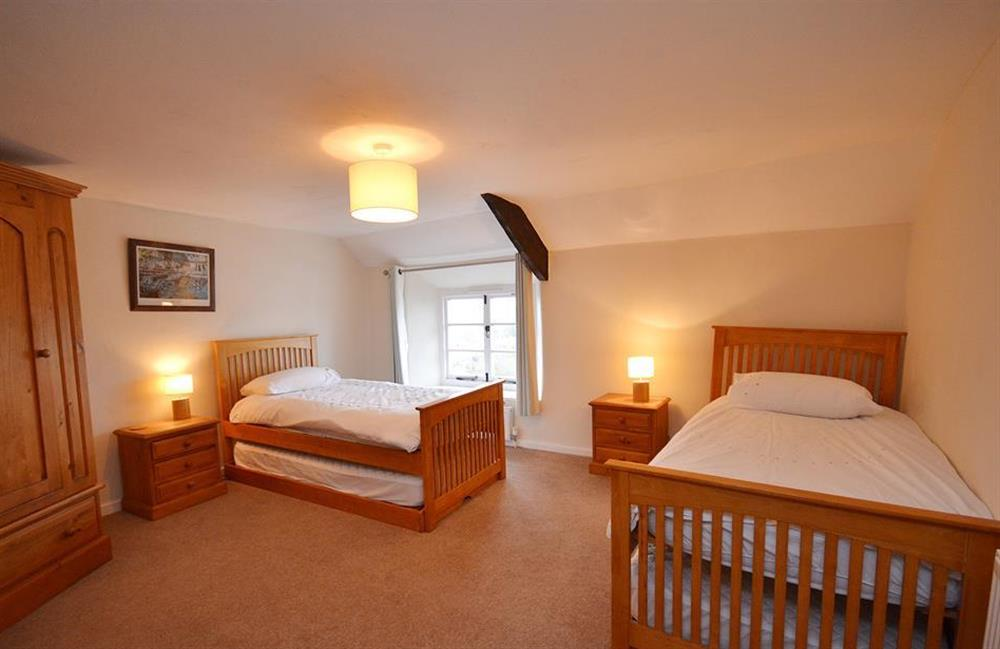 The spacious twin bedroom with two extra floor level pull out beds at Dower House, Dittisham