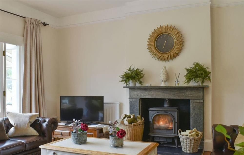 Ground floor: Sitting room two with wood burning stove and leading through to the conservatory