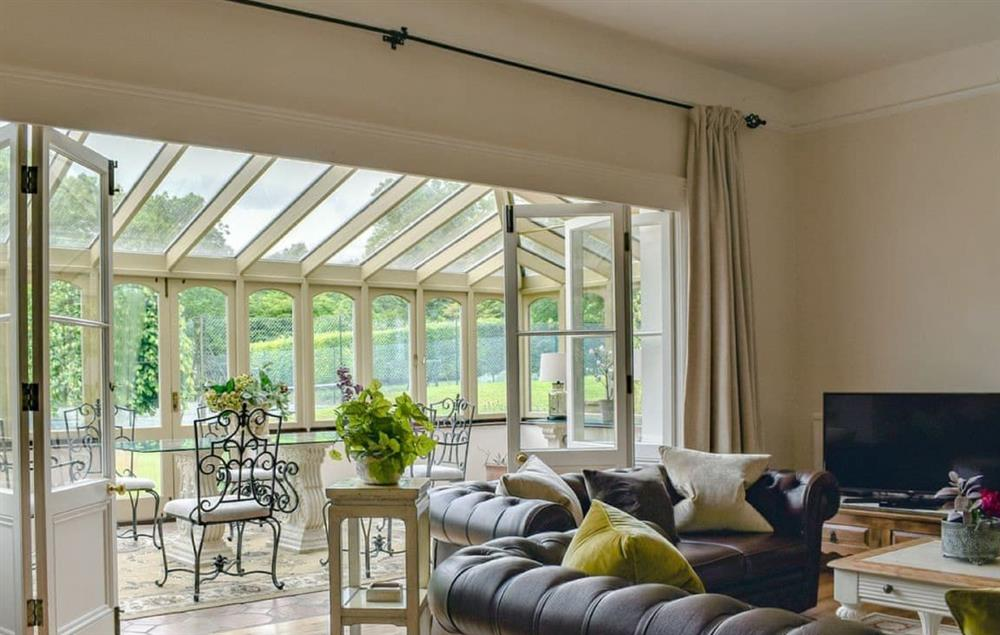 Ground floor: Spacious sitting room with wood burning stove and leading to the conservatory