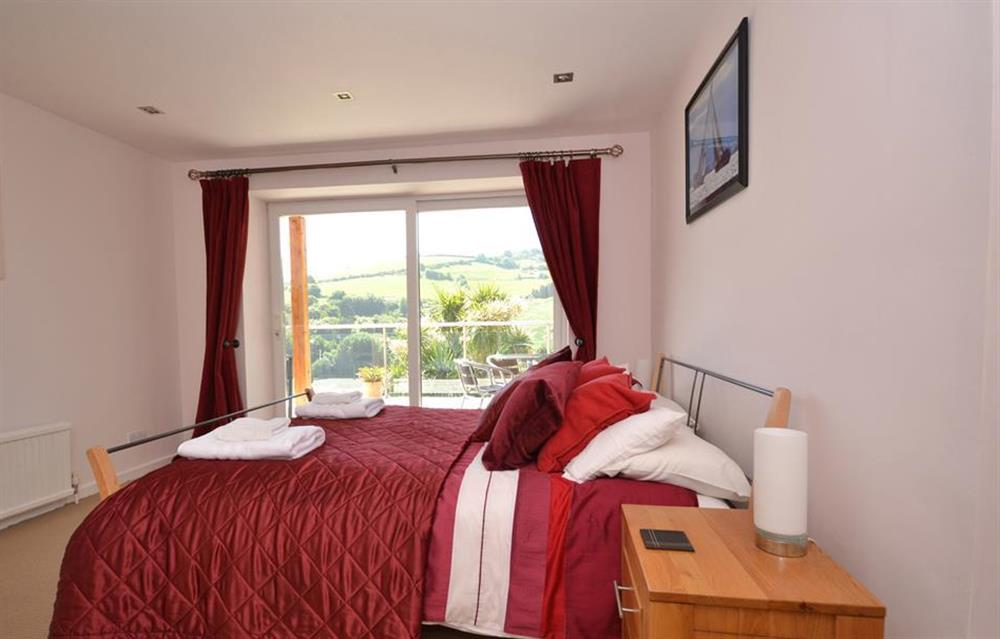 Another view of the master bedroom with en suite at Driftwood, Dartmouth