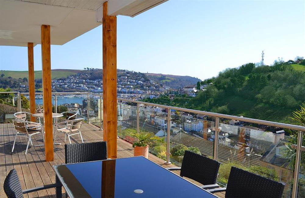 The decked terrace running the width of the house outside the bedrooms at Driftwood, Dartmouth