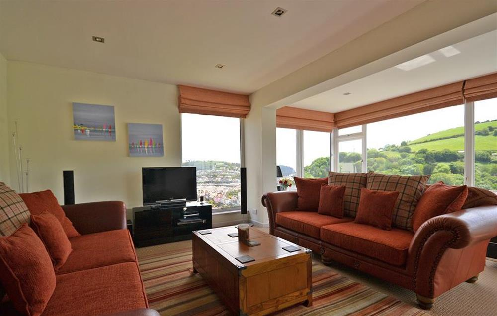 The sunny dual aspect lounge, with patio doors leading out to the top balcony at Driftwood, Dartmouth
