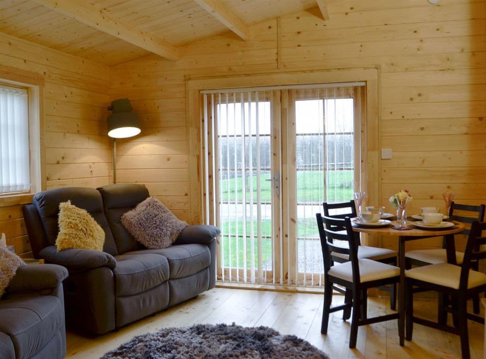 Comfortable living/ dining area at Dryslwyn Cabin in Pencoed, Glamorgan, Mid Glamorgan