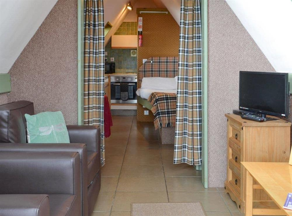 Open plan living space at Lochside Chalet,