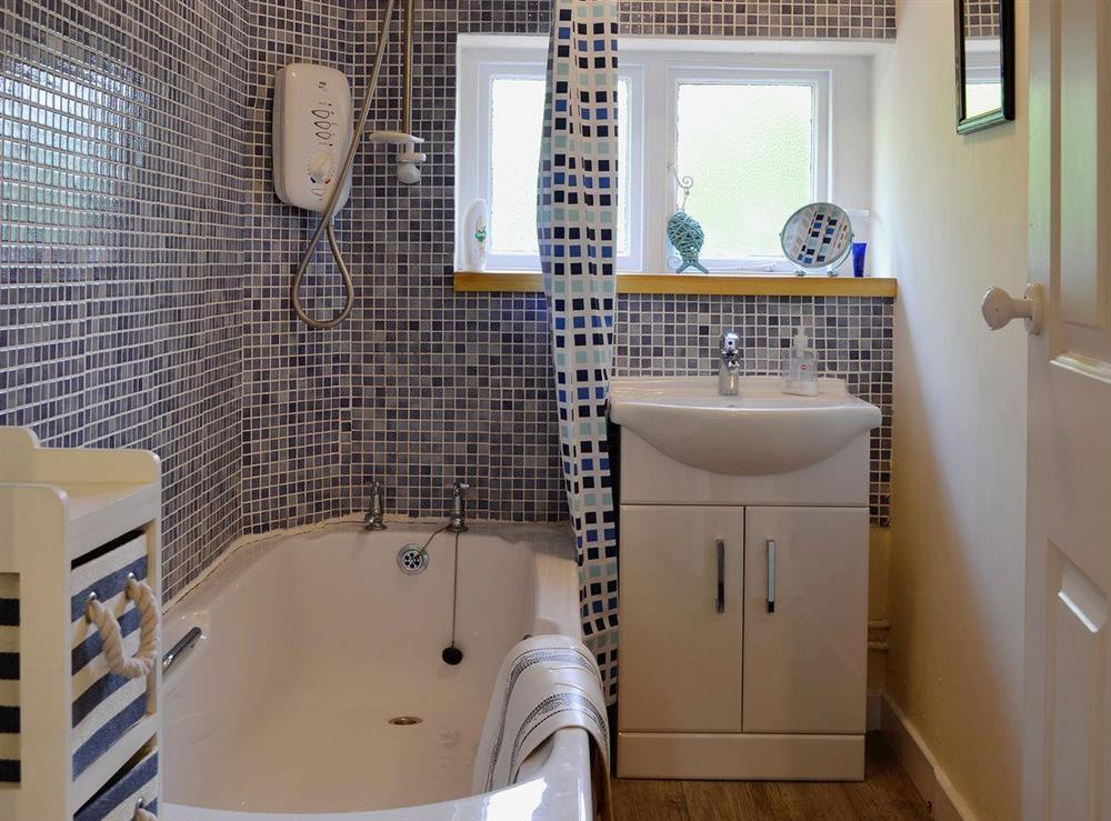 Delightfully tiled bathroom with shower over bath at Dunlappie Lodge in Edzell, near Brechin, Angus