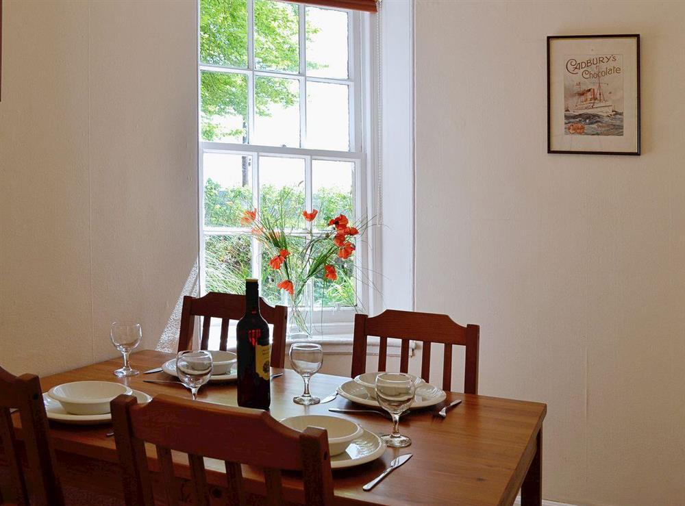 Dining room with lovely view over the garden at Dunlappie Lodge in Edzell, near Brechin, Angus