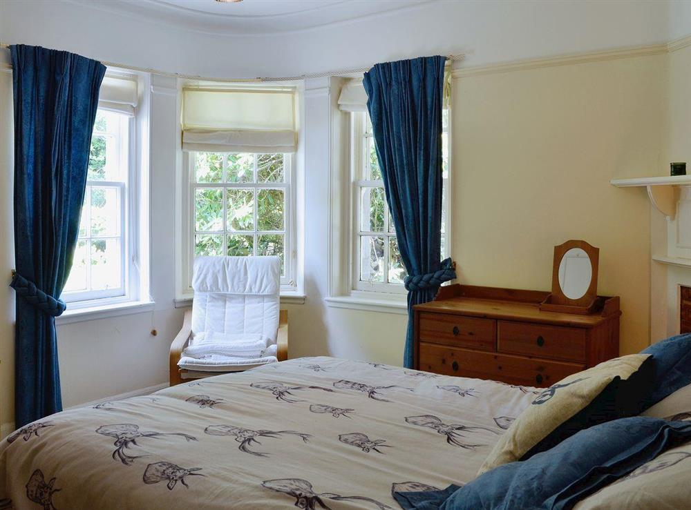 Lovely double bedroom with decorative fireplace at Dunlappie Lodge in Edzell, near Brechin, Angus
