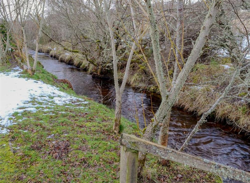 Lovely Highland river at the bottom of the garden at Dunrobin in Lairg, near Sutherland, Highlands, Scotland