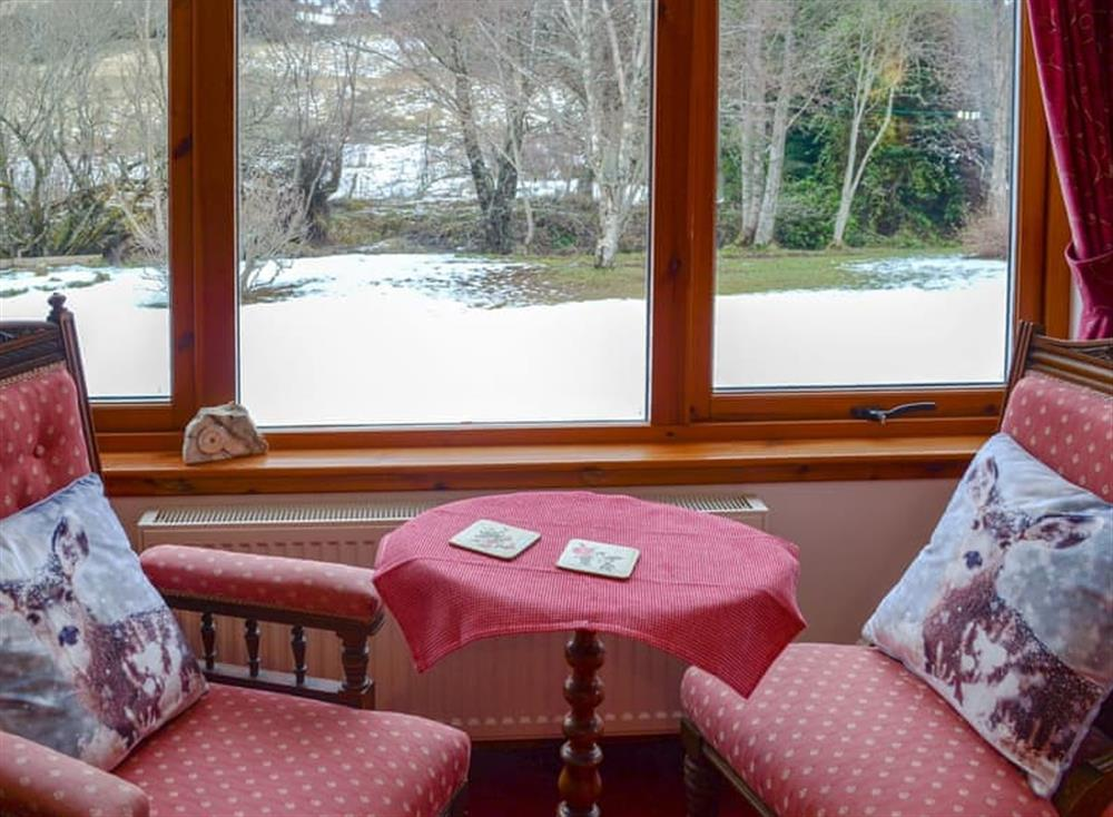 Views over the garden from the living room at Dunrobin in Lairg, near Sutherland, Highlands, Scotland