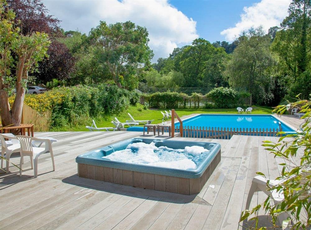 Outdoor hot tub at Edgecombe Barn in Bow Creek, Nr Totnes, South Devon., Great Britain