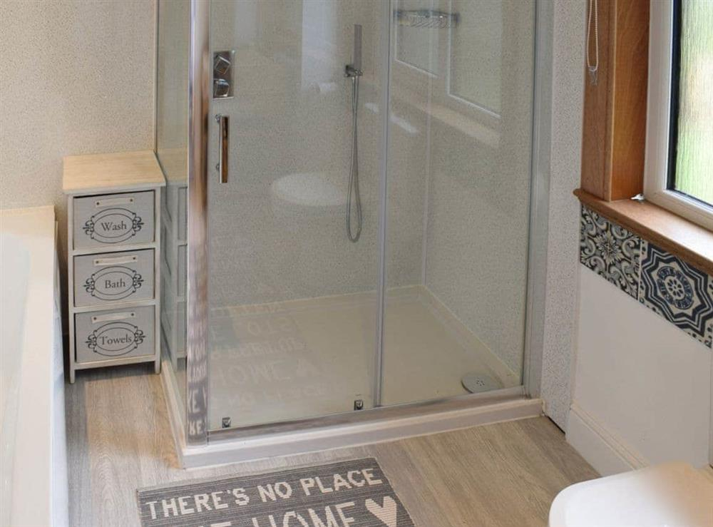 Bathroom with bath, shower cubicle, toilet and heated towel rail (photo 2) at Elm Cottage in Falkirk, Stirlingshire