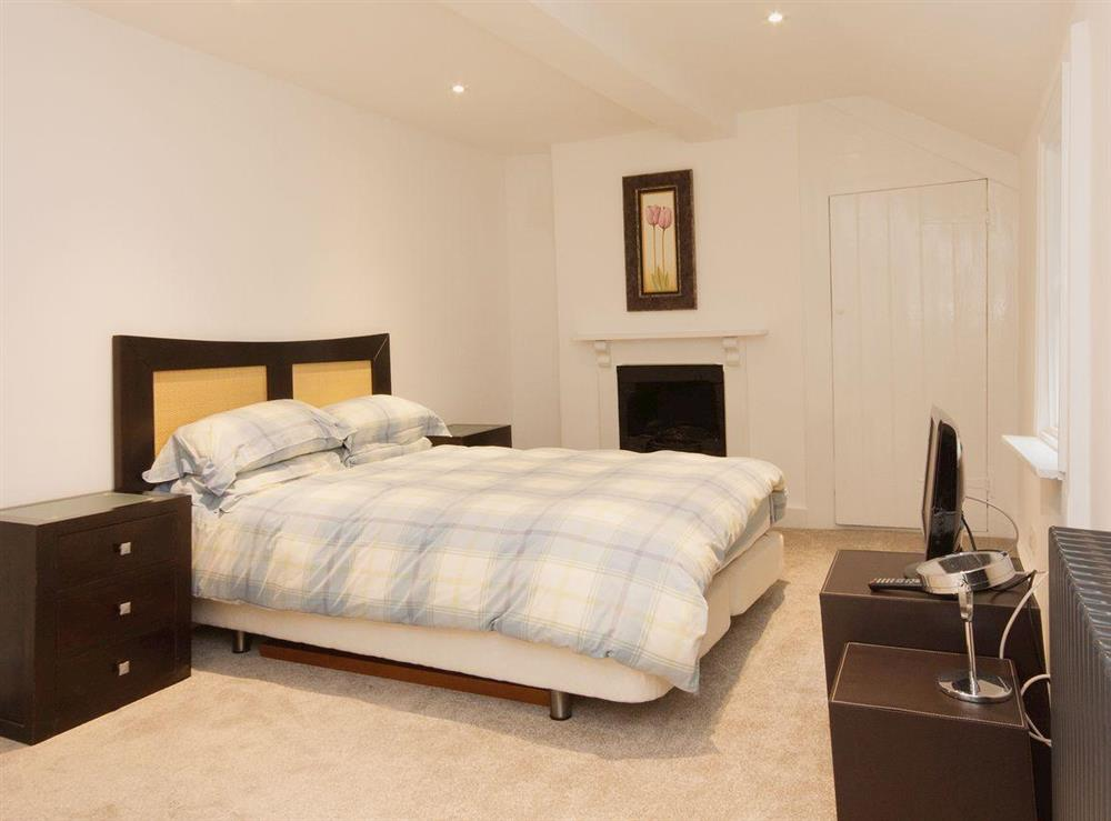 5' double bed and dressing area make the master bedroom luxurious and romantic at Elm Grove in Dartmouth, Devon