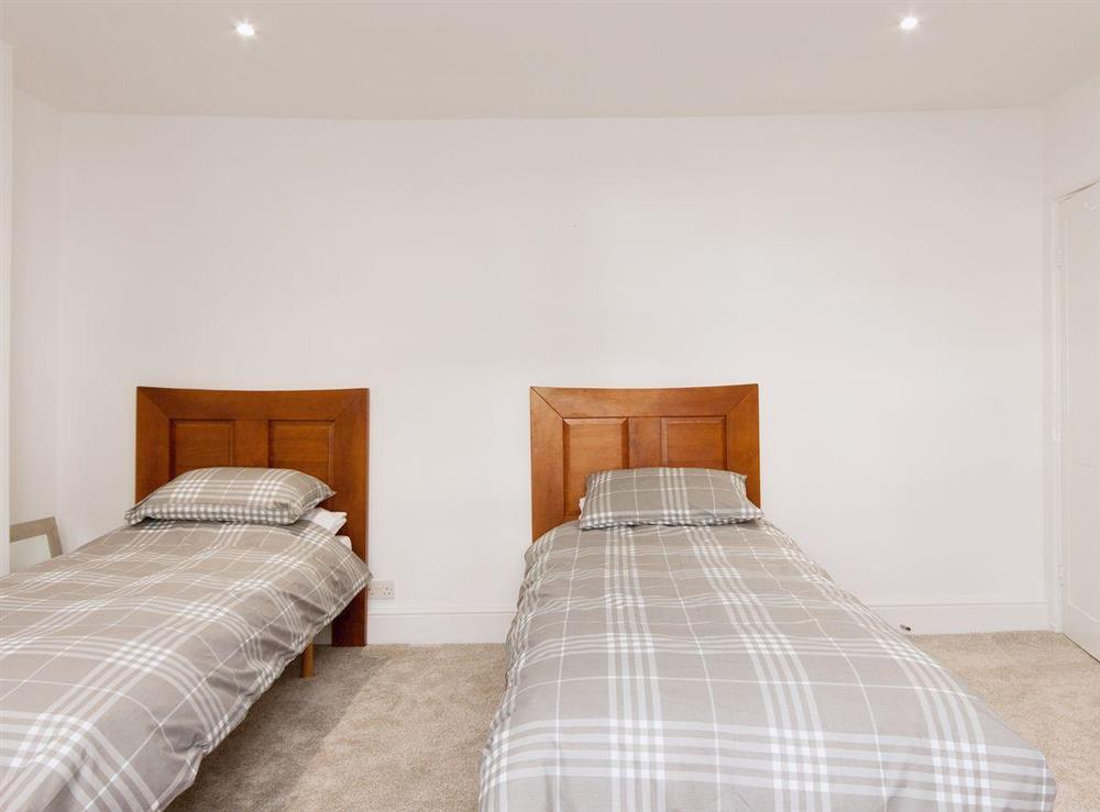 A cosy twin bedded room finishes off the bedrooms at Elm Grove in Dartmouth, Devon