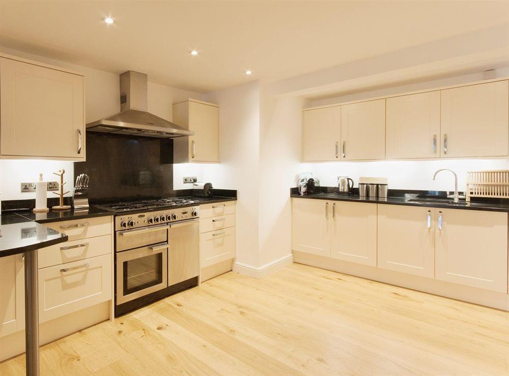 A range cooker is just one of the modern appliances in the well-stocked kitchen at Elm Grove in Dartmouth, Devon