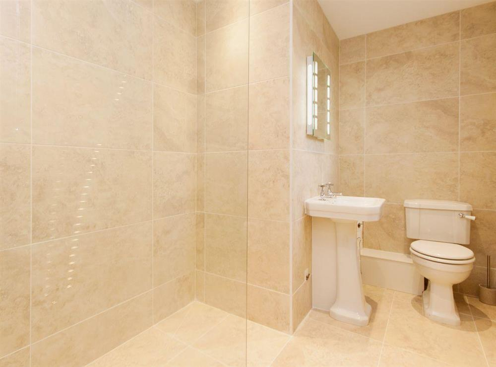 An en suite shower room, full tiled, is a great addition to the master bedroom at Elm Grove in Dartmouth, Devon