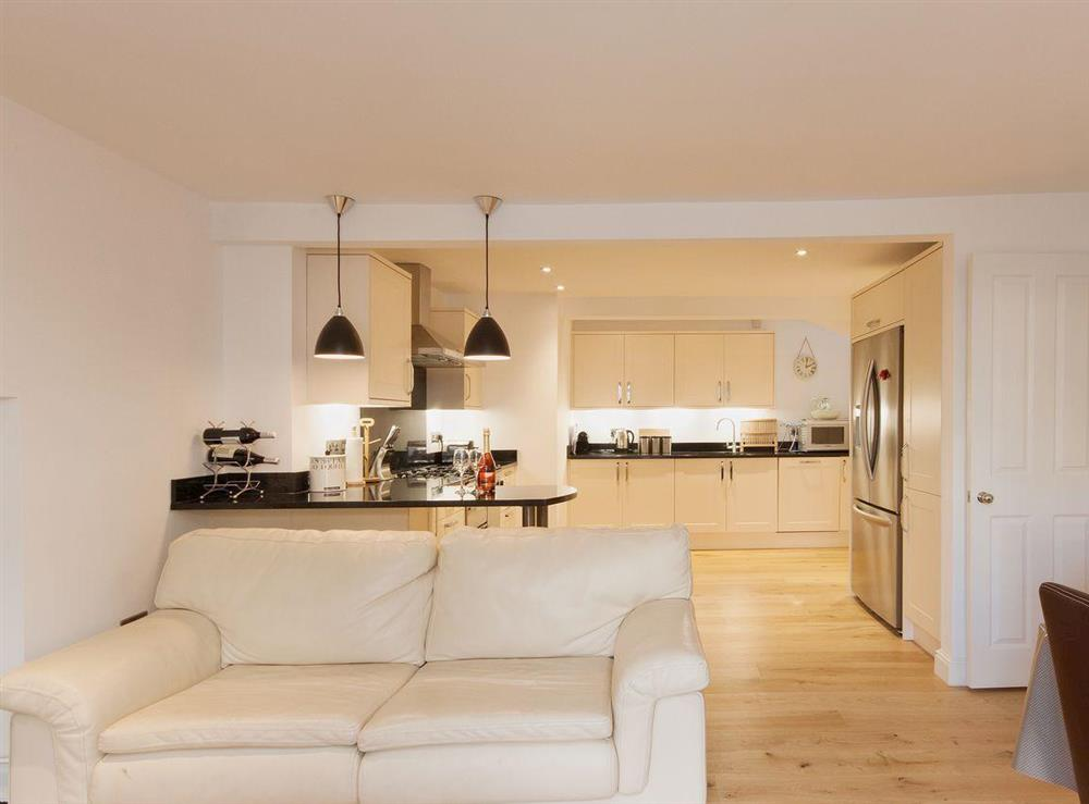 Leather sofas add to the contemporary, luxury feel of the dining area at Elm Grove in Dartmouth, Devon