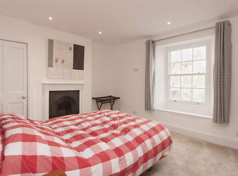 Light, bright, and comfortably furnished, the second double bedroom is welcoming at Elm Grove in Dartmouth, Devon