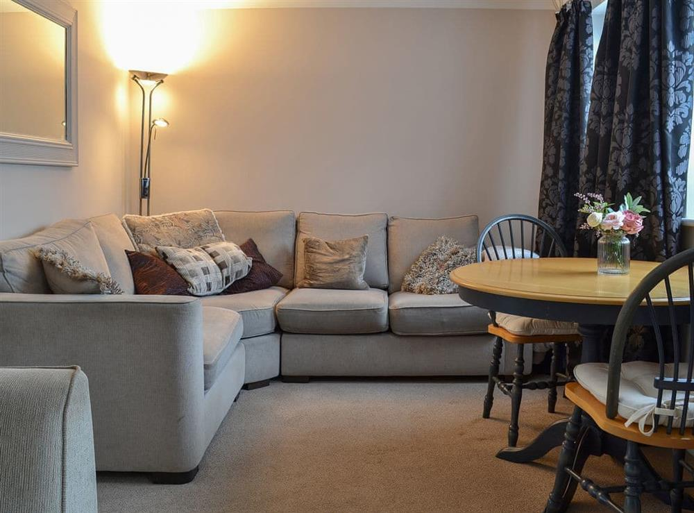 Cosy and comfortable living space with modest dining area at Ely Retreat in Ely, Cambridgeshire