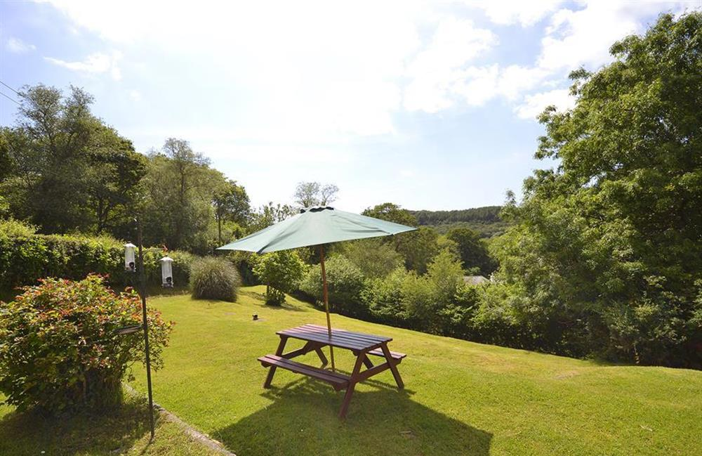 Outdoor seating area set in large garden at End O Moor, Shaugh Prior