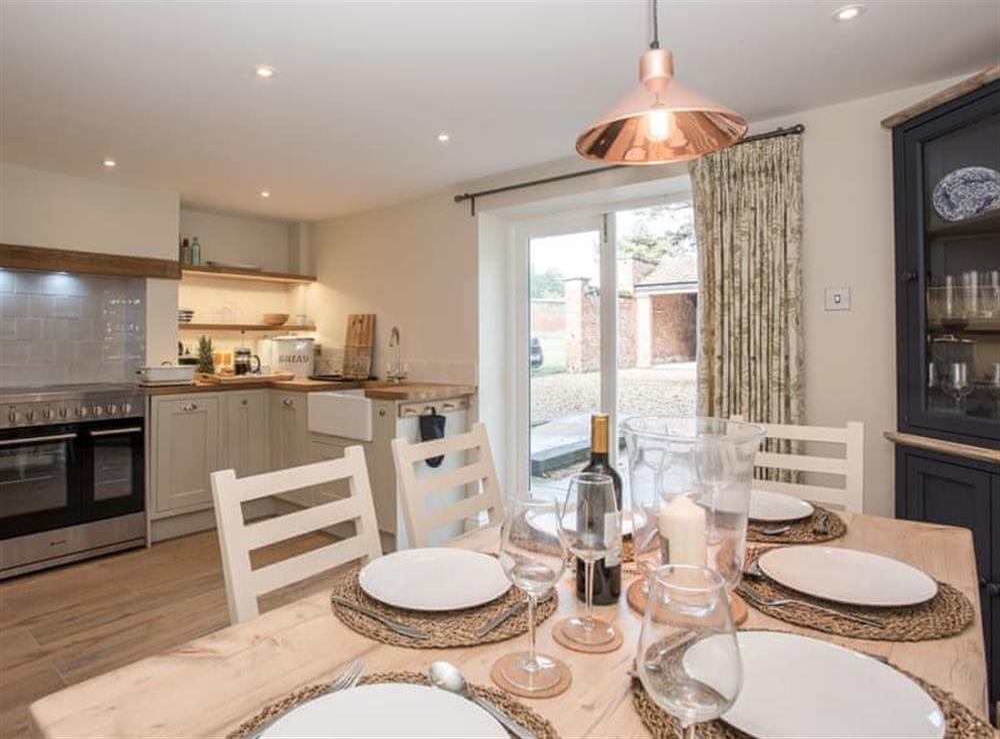 Kitchen and dining area at Estate Cottage in Warstead, near North Walsham, Norfolk