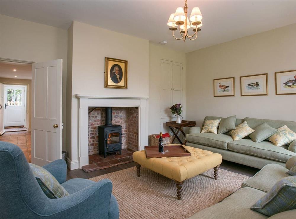 Living room with wood burner at Estate Cottage in Warstead, near North Walsham, Norfolk