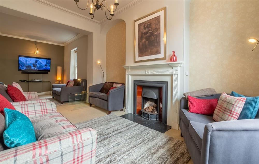 Ground floor: Large sitting room with Smart television and open fire