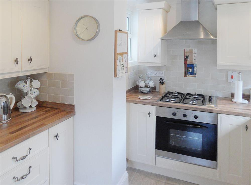 Contemporary kitchen design featuring gas hob at Evelyn Cottage in Dartmouth, Devon