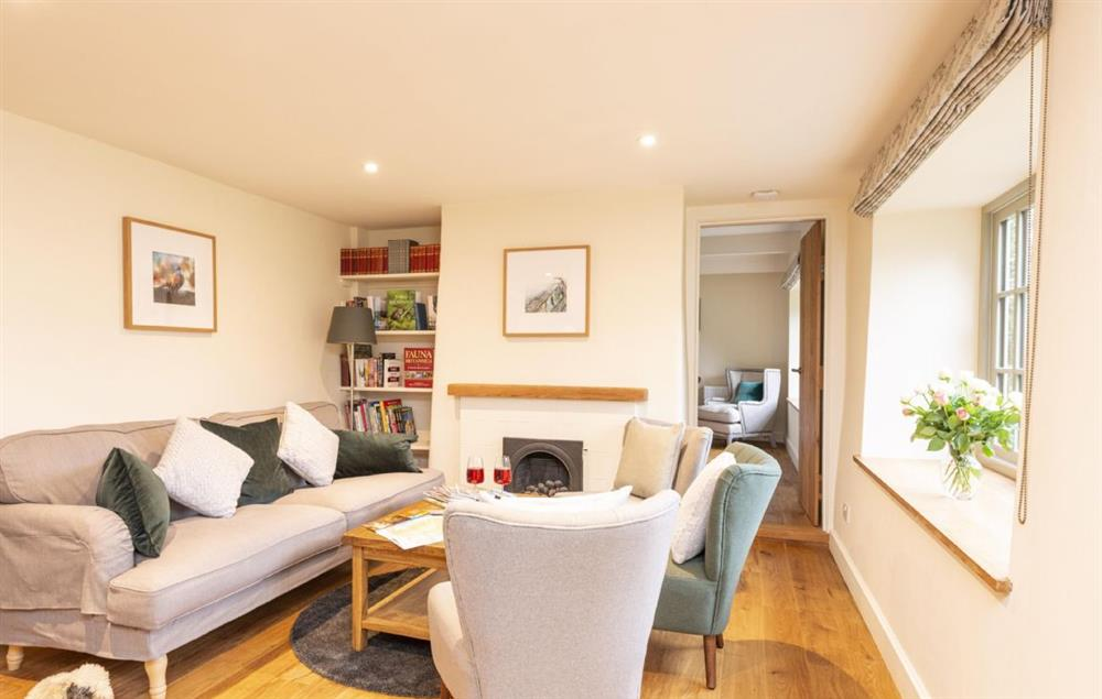 Ground floor: Open plan area with sitting room and gas flame effect fire