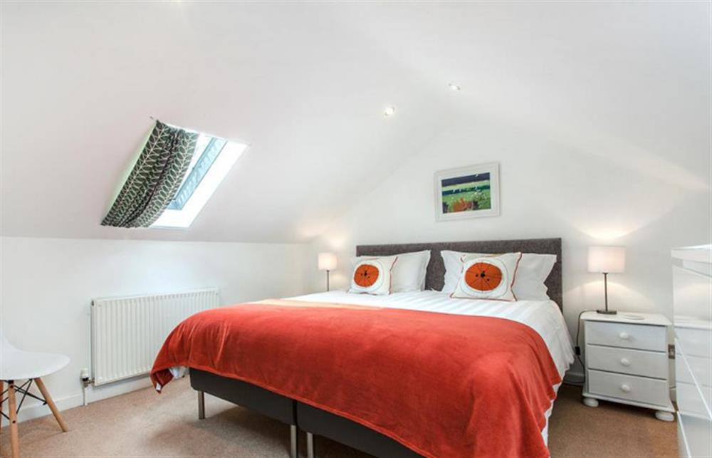 The top floor master suite with super-kingsize bed. at Fairholm, Stoke Fleming