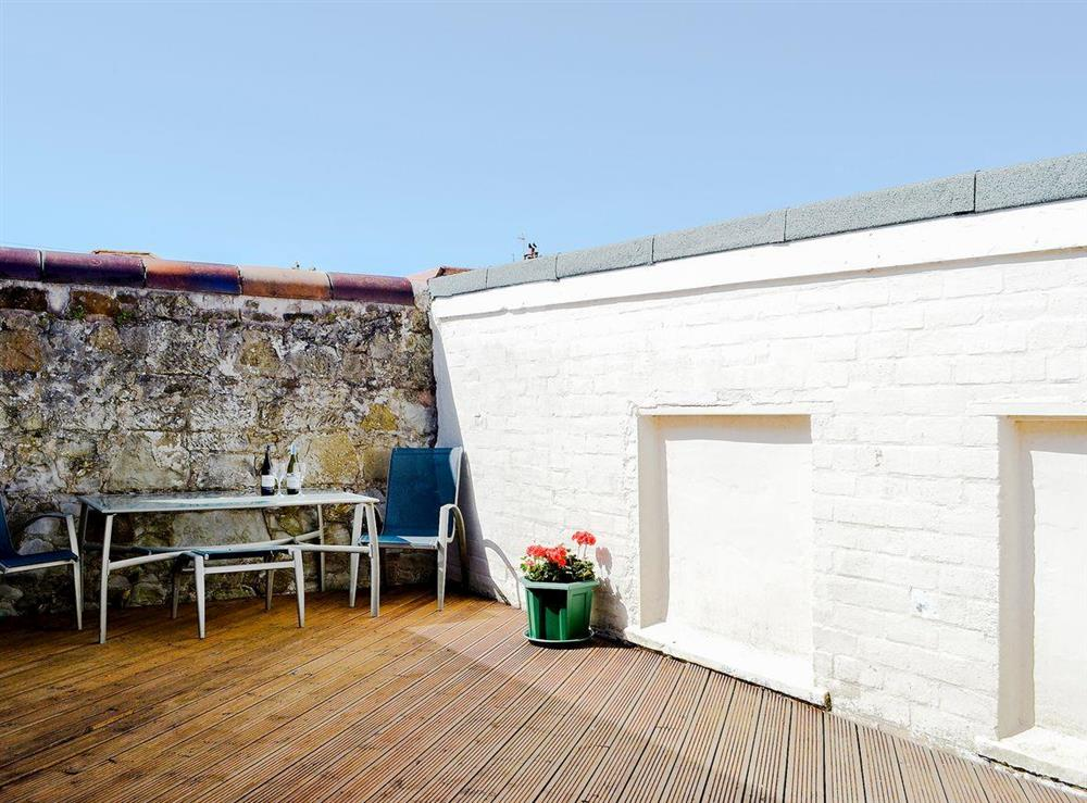 Sheltered and secluded shared decked area with seating at Number 3,