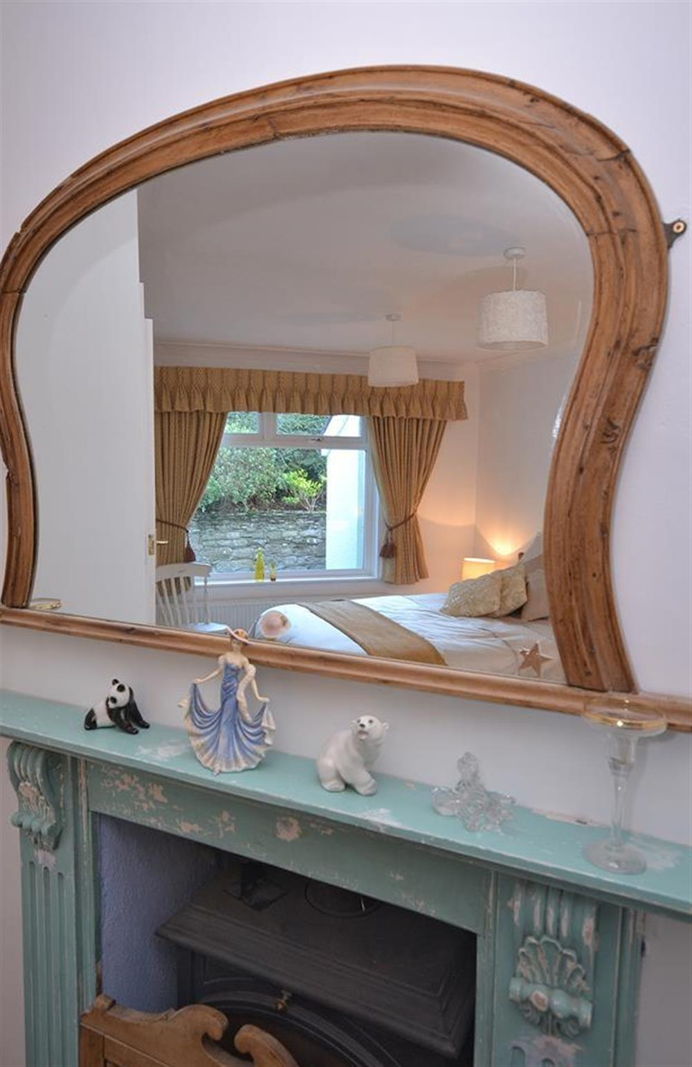 Feature fireplace in the bedroom at Fairwinds, Strete