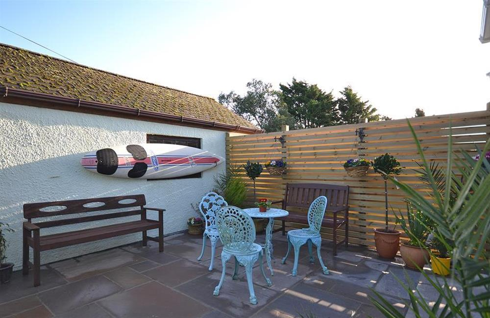 Step out of the lounge with your morning coffee on the private patio at Fairwinds, Strete