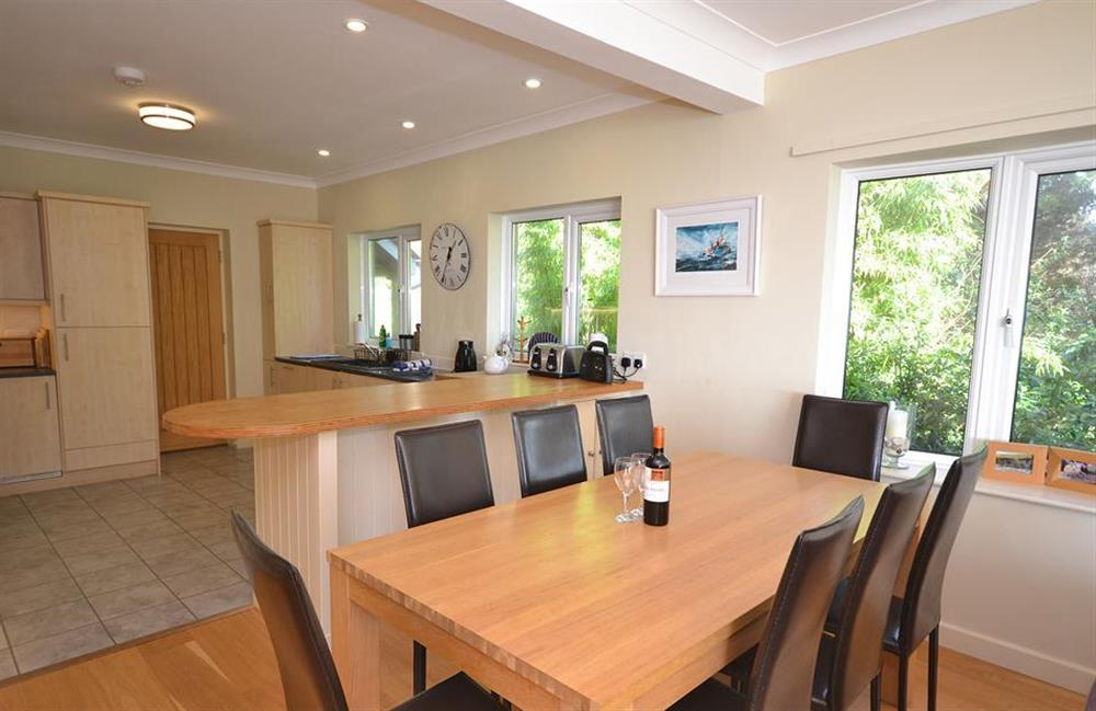 The dining area and modern kitchen at Fairyfield, Stoke Fleming