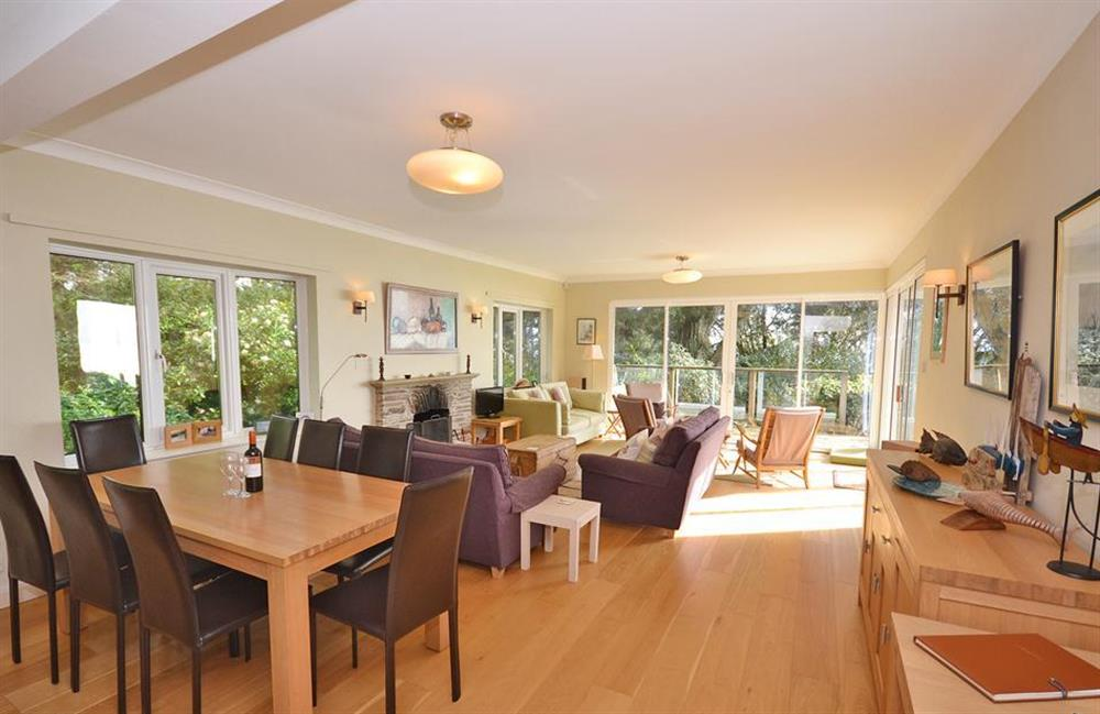 The living room with the dining area in the foreground at Fairyfield, Stoke Fleming