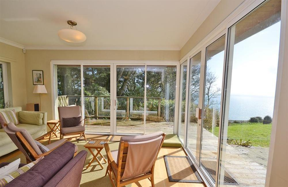 The sunny living room seating area with fantastic sea views at Fairyfield, Stoke Fleming