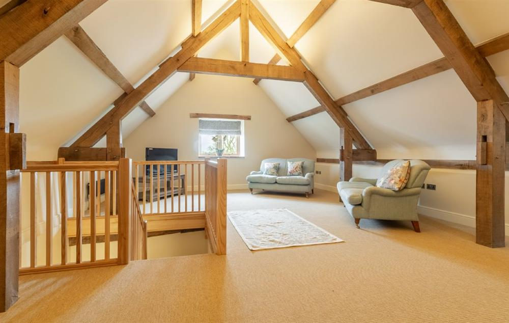 First floor: Sitting room with three sofas, armchairs, reading/games area and Smart television