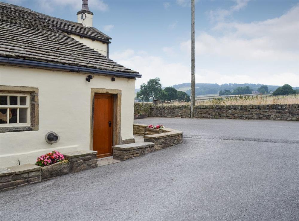 Semi-detached cottage is set on the owner's working farm at Far Barsey Cottage in Barkisland, near Halifax, West Yorkshire