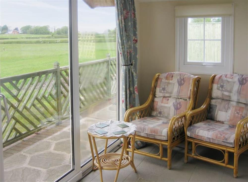 Airy sun room with rural views at Fernbank Lodge,