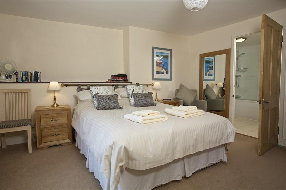 Master bedroom with King-size bed and en suite bathroom at Ferry View (Dartmouth) in South Town, Dartmouth