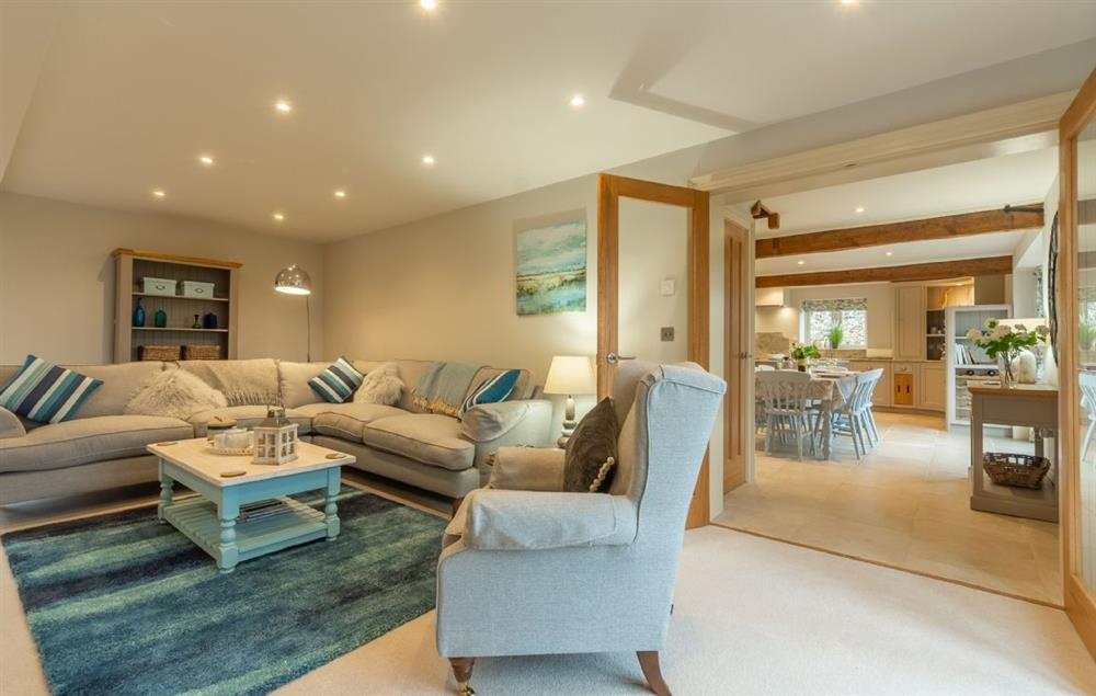 Ground floor: Spacious sitting room with comfortable sofas and a wood burning stove