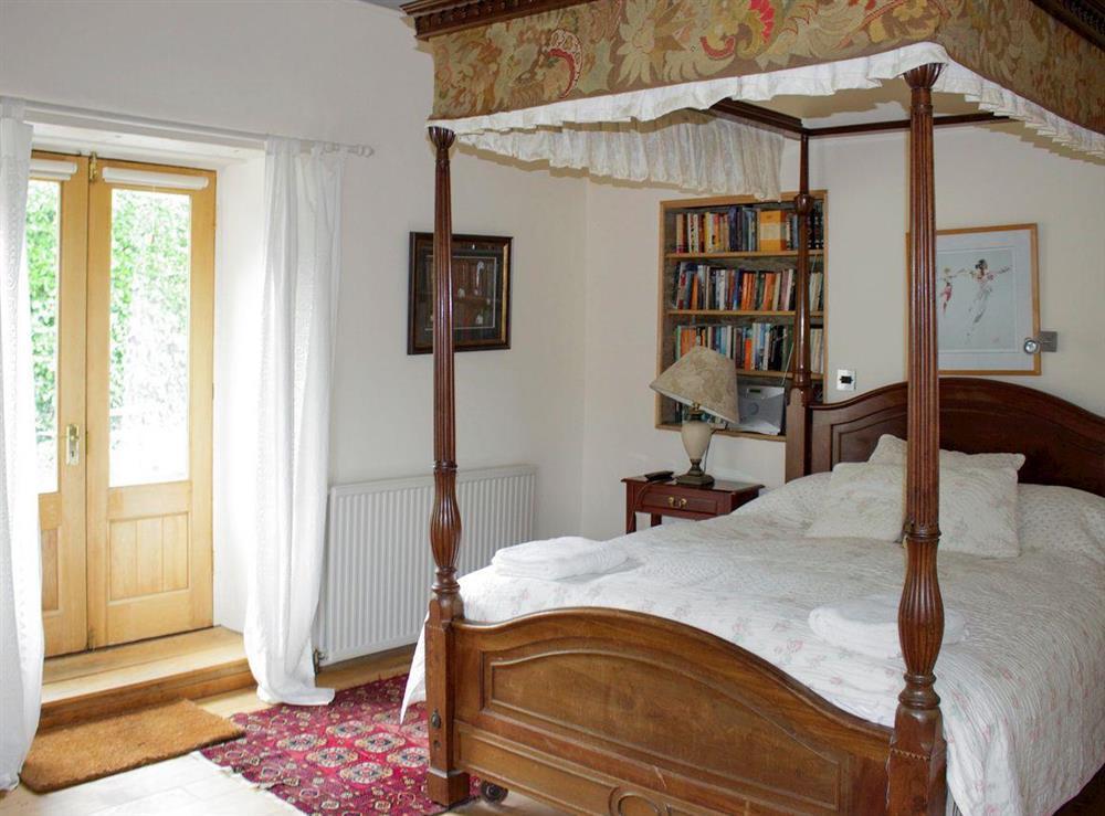 Elegant four poster bedroom at Upper Mill,