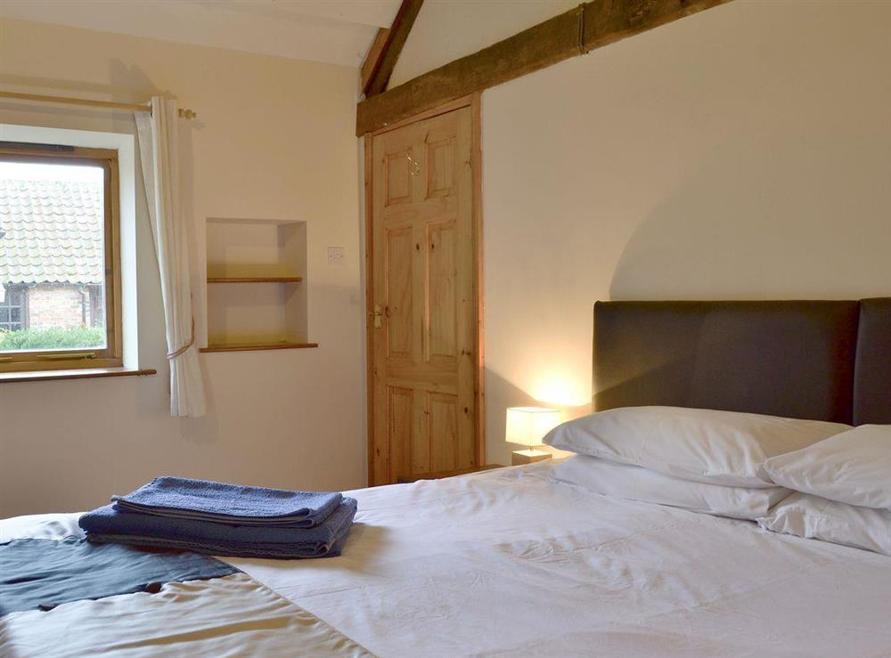 Comfortable double bedroom at Fitling Cottage in Fitling, near Hull, North Humberside
