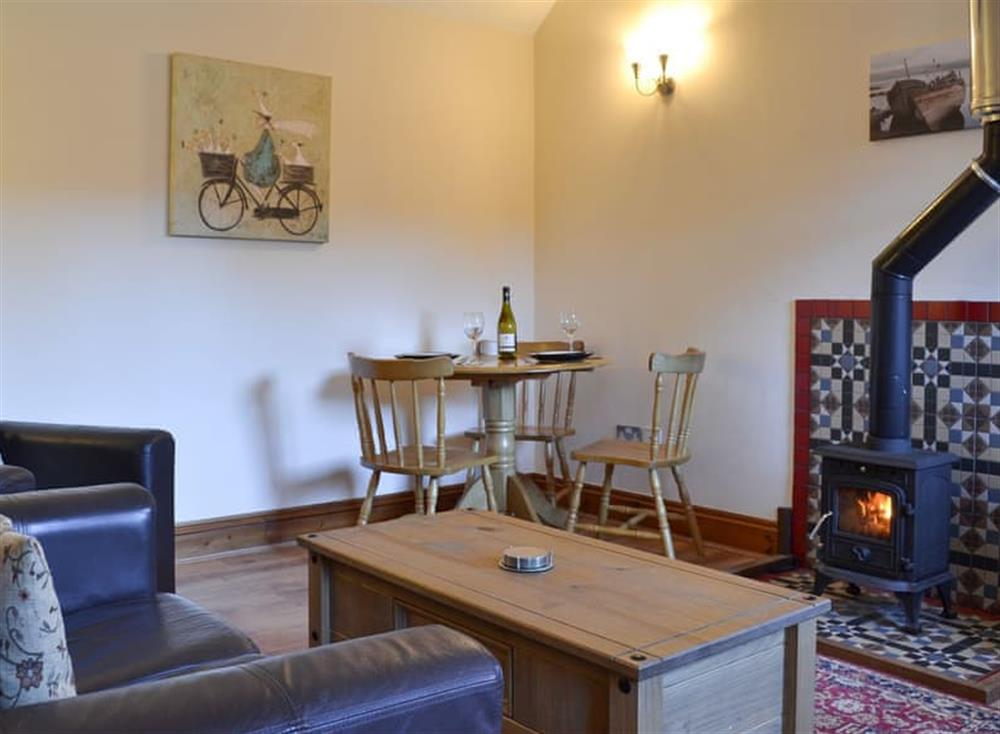 Warm and cosy living area at Stables Cottage,