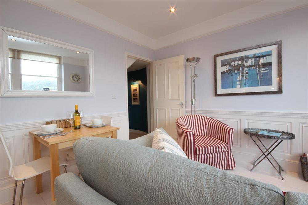 Open plan room with dining table for two at Flat 1, 32 Newcomen Road in The Plaice, Dartmouth