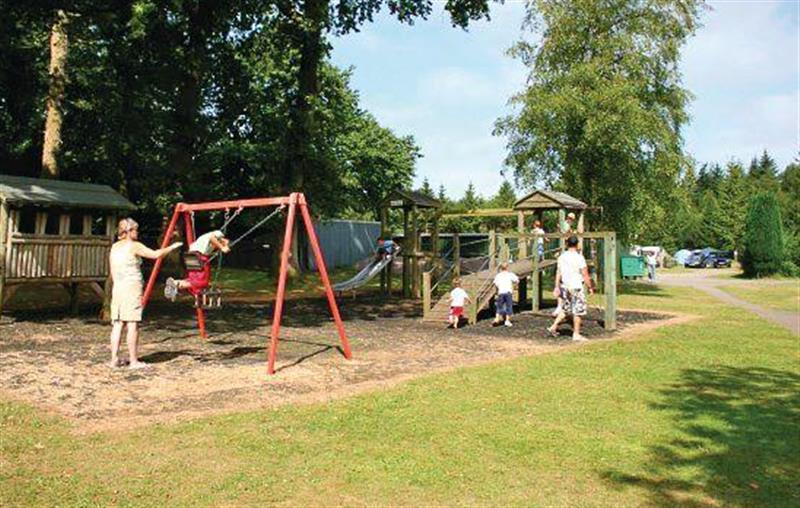 Children's play area at Forest Glade Holiday Park in Kentisbeare, Nr Exeter, Devon